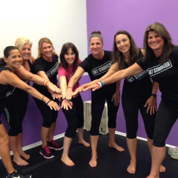 Her Fitness Hands In Group Photo Picture